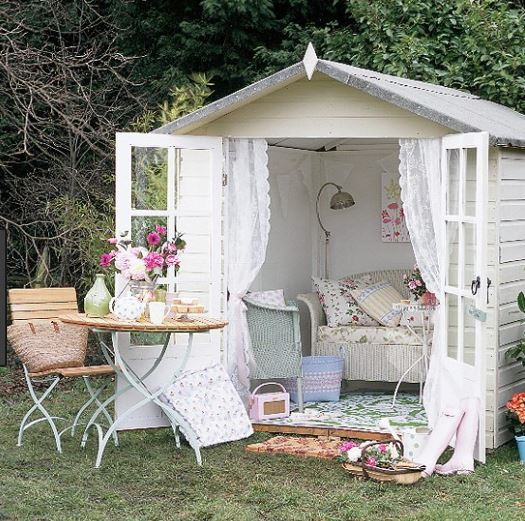 A white shed, representing how white can make your she shed look girly and cute