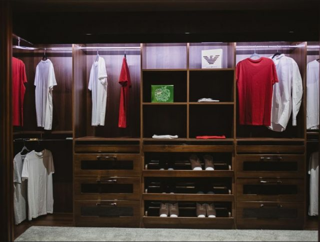 A image of a wooden walk in closet design in which would be perfect for any she shed